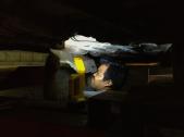 Roadside mechanic ripping a heat shield off the bottom of our rental sedan - Veracruz, Mexico